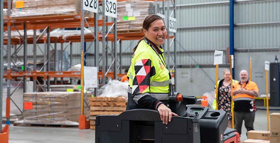 border express warehouse staff operating machinery